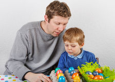 Little boy and his mother being happy about selfmade Easter eggs Stock Images
