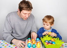 Little boy and his mother being happy about selfmade Easter eggs Royalty Free Stock Photography