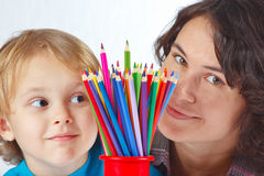 Little boy with his mother with color pencils Royalty Free Stock Photos