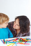 Little boy with his mother draws with color pencils Stock Image