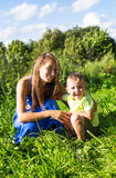 Little boy with his mother outdoors Royalty Free Stock Photo
