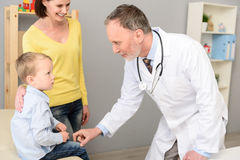 Little boy with his mother at paediatrician on consultation Royalty Free Stock Image