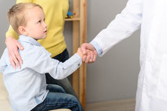 Little boy with his mother at paediatrician on consultation Stock Image