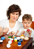 Little boy with his mother paint the Easter eggs Royalty Free Stock Image
