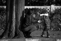 Little boy and his mother Stock Images