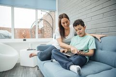 Reading With Mum at Home Royalty Free Stock Photography