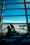 Little boy and his mother sitting in an airport Royalty Free Stock Photo