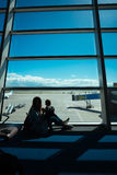 Little boy and his mother sitting in an airport Royalty Free Stock Photos