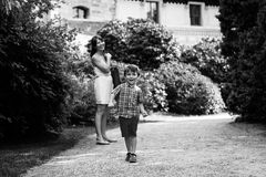Little boy with his mother Stock Images