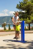 Little boy with his mother on the street doing fitness trainer Royalty Free Stock Images