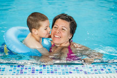 Little boy with his mother. In swimming pool Stock Photos