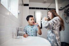 Siblings Brushing Their Teeth stock image