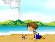 A little boy and his pet at the beach Stock Photography