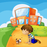 A little boy and his pet near the school Royalty Free Stock Photography