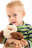 Little boy with his plush puppy. Isolated on white Royalty Free Stock Photos