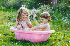 Little boy and his sister girl playing with water in bath. Healthy, happy, childhood concept Royalty Free Stock Image