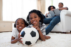 Little boy and his sister holding soccer ball Royalty Free Stock Images