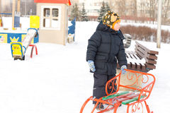 Little boy with his sled in winter snow Stock Photos