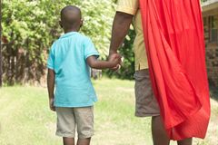 Little boy with his super hero father. African American little boy super hero playing outside royalty free stock photos