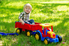 Little boy in his toy truck Royalty Free Stock Image
