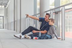 Little boy and his trainer taking a break and making selfie stock images