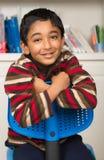 Little Boy at his Work Desk. Smiling Portrait of a Little Boy at his Work Desk Stock Images