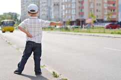 Little boy hitching a ride Royalty Free Stock Photos