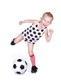 Little boy hits a soccer ball Stock Images