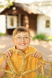 Little boy hold braided straw in hands royalty free stock photo