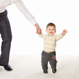 The little boy hold the father's hand.  royalty free stock image