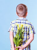 Little boy hold flowers behind back. Stock Photography