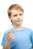 Little boy hold glass of water. Stock Photos