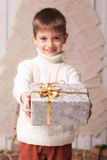 Little boy hold present in Christmas interior Royalty Free Stock Images