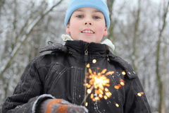 Little boy hold sparkler in forest Stock Image