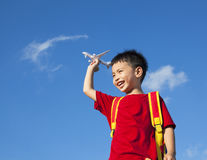 Little boy holding a airplane toy with a backpack Royalty Free Stock Photo