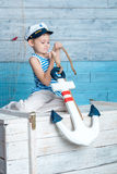 Little boy holding anchor Royalty Free Stock Photo