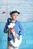 Little boy holding anchor Stock Image