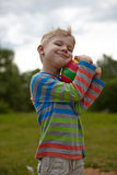 Little boy holding a ball Royalty Free Stock Photo