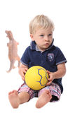Little boy holding ball Royalty Free Stock Image
