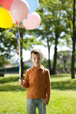 Little boy holding balloons. Outdoors Royalty Free Stock Photos
