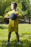 Little boy holding a basketball. Portrait of a little boy holding a basketball Stock Images