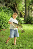 Little boy holding a bass Royalty Free Stock Photos