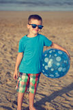 Little boy holding beach ball in vintage style Royalty Free Stock Photos