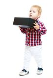 Little boy holding a big black box. Stock Image