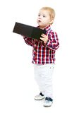 Little boy holding a big black box. Royalty Free Stock Photo
