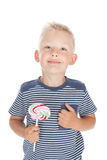 Little boy holding a big candy Royalty Free Stock Images