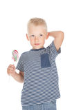 Little boy holding a big candy Stock Photo