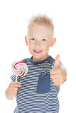 Little boy holding a big candy Royalty Free Stock Image