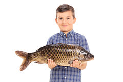 Little boy holding a big fish. Isolated on white background stock image