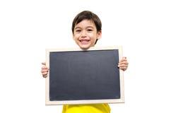 Little boy holding a blackboard Royalty Free Stock Photos